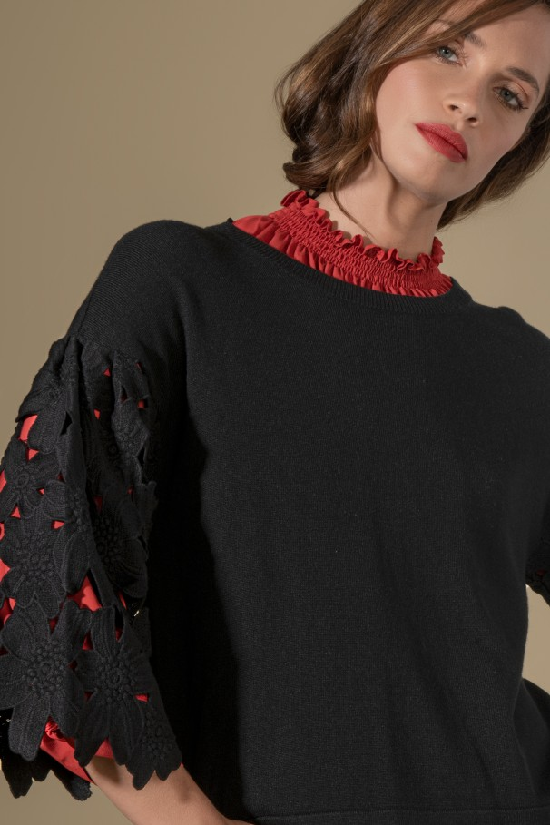 Sweater with perforated embroidery sleeves
